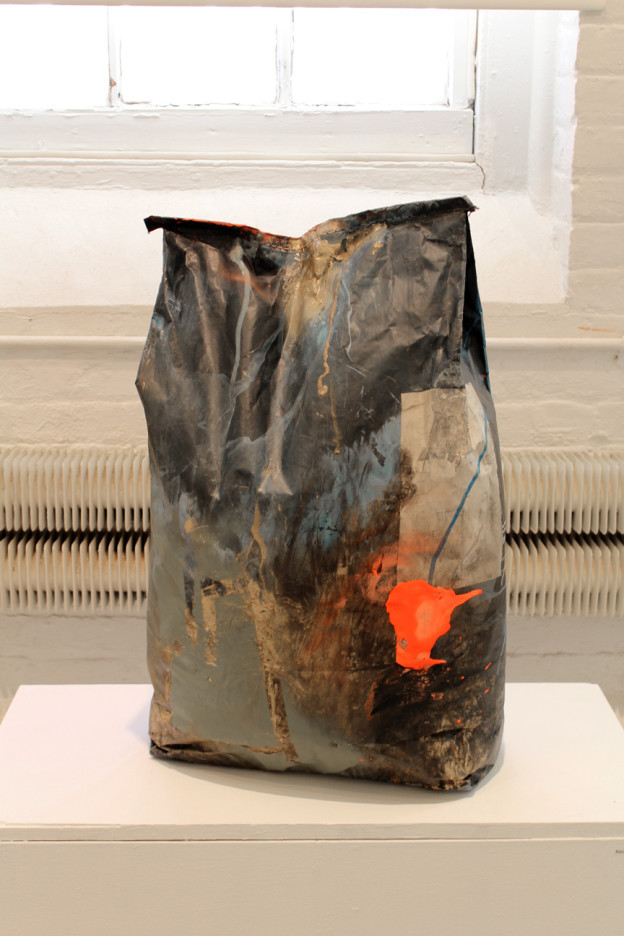 "Kim Smith - Coal, Acrylic, Enamel on Bag of Charcoal, 15"" x 30"", 2013"
